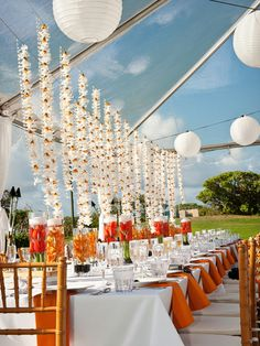 Oahu oceanfront wedding! I loved Stacey and Greg's combination of sunny orange and contemporary grey.  Guests had decor on the tables as well as above their heads!  Their wedding was on the oceanfront Kuilima Point at Turtle Bay Resort on O'ahu's iconic North Shore. Michelle Garibay Events