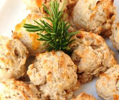 Rosemary-Cheddar Drop Biscuits    1 cup all-purpose flour    1 cup white whole wheat flour    2 tsp baking powder    1/4 tsp salt    2 tsp sugar (optional)    1 cup shredded low-fat sharp cheddar cheese    1 tbsp finely chopped fresh rosemary    1 cup 2% Greek yogurt (or sour cream)    6 tbsp unsalted butter, melted