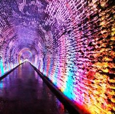 railway tunnel is illuminated in a rainbow of color as it passes under the streets of this small city.Canada's oldest railway tunnel is illuminated in a rainbow of color as it passes under the streets of this small city. Tunnel Of Love, Emergency Lighting, Free Travel, Adventure Is Out There, Canada Travel, Abandoned Places, Wonders Of The World, Scenery, Around The Worlds