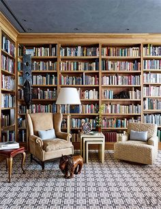 A traditional library with wood built-in bookshelves | archdigest.com                                                                                                                                                      More