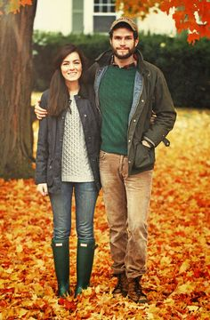 Couple in autumn complete with sweaters, jackets, colorful leaves, and Wellingtons! Cute!!
