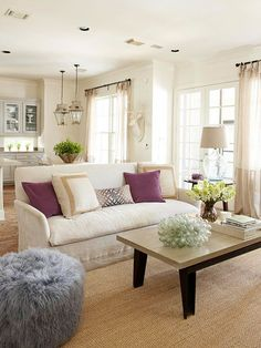 Set the tone of your open layout by dividing a large living/dining space into separate zones with furniture placement.
