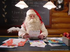Santa Claus reading letters in Santa Claus' Post Office in Rovaniemi in Finland