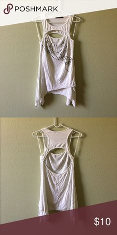 Studded asymmetrical tank White asymmetrical racer back tank with stud detailing & a cutout bust & back. ❤ Tops