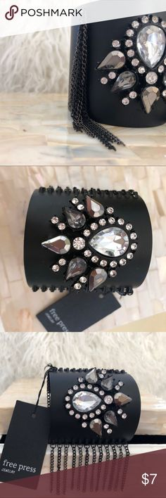 Matte Black Jeweled Cuff with chain Fringe NWT Really cool matte black cuff studded with gunmetal and clear sparkly stones.  There is also chain fringe on either side. New with tags. free press Jewelry Bracelets