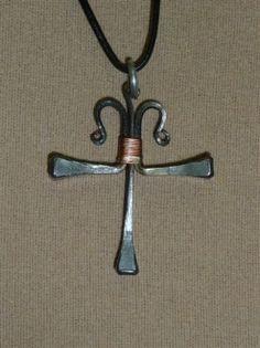 Fancy scrolled Horseshoe Nail Cross