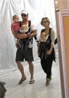 Chris Hemsworth and Elsa Pataky arrive at Los Angeles International Airport with their kids India, Tristan and Sasha on Aug. 25, 2014.