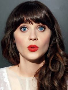 Zooey Deschanel She's always got perfect make up! I love her old fashioned look :)