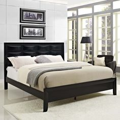 Harrison Queen Bed, Black - A luxurious and distinctive addition to any bedroom suite, the laminated charcoal veneer Harrison series features raised oblong paneling and an effulgent black sheen. Harrison's prominent demeanor evokes restful quietude for a peaceful repose. The series requires assembly, and should be wiped clean with either a dry cloth, or something intended for wood furnishings. The bed does not include a mattress or box spring. Includes a queen size frame (also available in a…