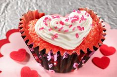 Perfect for Valentine's Day, these strawberry-flavor cupcakes feature a secret ingredient (JELL-O Gelatin) plus an easy trick to make the fun heart shape.
