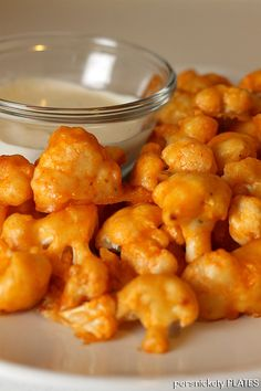 ~ Baked Buffalo Cauliflower ~ make a batter of 1/2 c flour, 1/2 c water, dash of Frank's sauce (wings or original), 1/4 t garlic salt, 1/4 dried onion ~ cut cauliflower and dip in batter ~ place on foil lined baking sheet sprayed with nonstick spray ~ bake 15 mins. at 450 degrees ~ or until batter hardens ~ cover in wing sauce ~ bake a few more minutes (sauce will dry) ~