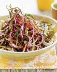 Crispy Okra Salad | Contributed By: suvir Saran | The usual Indian way of preparing okra is to cut it into rounds. But when Suvir Saran was seven, he insisted that the family cook slice the okra into wispy strips. The supercrunchy result was a hit and became a family legend; today he serves it at both of his restaurants, Dévi and Véda. | From: foodandwine.com