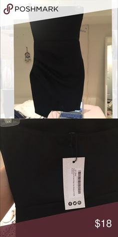 Strapless black bodycon dress Tight short black strapless bodycon with uneven bottom hemline.  Can be dressed up with heels or dressed down with an oversized jacket or cardigan Boohoo Dresses Mini