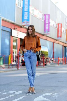 The 12 Most Popular Italian Street-Style Stars to Know - Giorgia Tordini wearing high-waist mom jeans and a burnt orange silk top