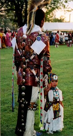 Choctaw Nation of Oklahoma Pow Wow: A dancer and his child