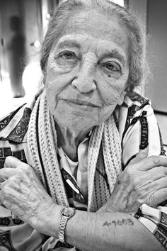 Auschwitz survivor A-7603--Dora Apsan Sorell, MD--in whose eyes are reflected the beauty of wisdom and the horror of her past. In 2003, she received a $3,043 reparations check for the slave labor she did during the war, which she donated in full to a Jewish organization that provides humanitarian relief in Darfur.