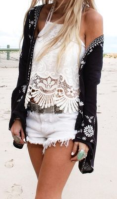 Helen Janneson Bense is wearing an embroidered  lace trim top from Urban Outfitters, kimono jacket and white denim shorts from Free People