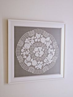 All white framed Hungarian embroidery mounted on grey silk // Hungarian Embroidery 101 - History | Dans le Lakehouse