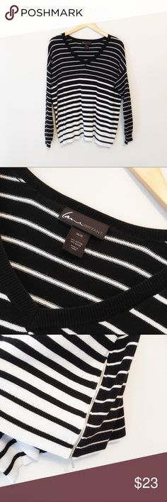 """Lane Bryant V-Neck Sweater Size 14/16 Lane Bryant black and white striped v-neck lightweight sweater with side zippers.   PRODUCT DETAILS * Size 14/16 * 60% Cotton 40% rayon * Machine wash tumble dry * EUC * Pet free smoke free  Measurements taken flat ▫️Bust 23"""" ▫️Length 26""""  T.10.17 Lane Bryant Sweaters V-Necks"""