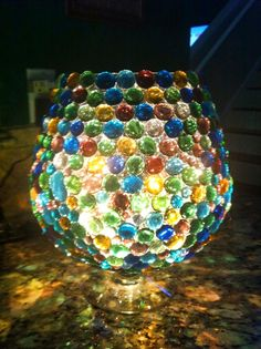 This is a large brandy snifter that I glued glass gems on and then put a string of white lights into the bowl for illumination!