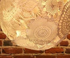 It's time to give the dated doily a facelift - and what better way than really highlighting the unique lace patterns in a lamp!  It took me a few tries, but...