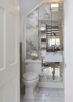 Get An Expensive Look In Your Bathroom For Very Little Money One Way To Cheat On The Of A Large Mirror Is Use Smaller Gl Tiles Or Secti
