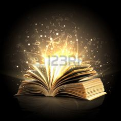 Opened magic book with magic lights photo