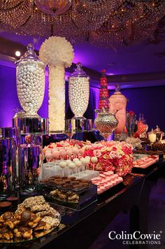A glamorous dessert station offers everything from pink macaroons to glittering cake pops!