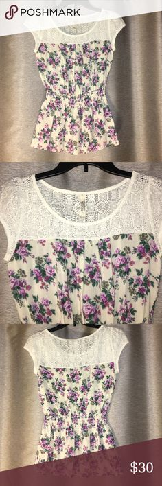 Cream top with purple floral print and cream Lace Never worn. Cream top with purple floral print and upper portion lace. Elastic waist adds style. Size small by Sound & Matter Sound & Matter Tops Tees - Short Sleeve