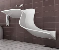 This is awesome.  1. It's a sink  2. It's a urinal 3. It has a drain in the floor.  I would add a spray nozzle, and mopping the bathroom floor would be easier than ever, and my toilet would forever be pristine, complete with the lid down.