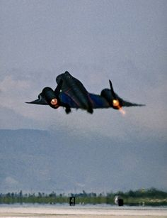 An SR-71 blackbird takes off with full afterburners.