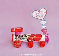 """Valentine's Day Candy Train with a Free Printable that says """"Valentine, I Choo Choo's You"""". Including Hershey's Chocolate Kisses, Reese's, M&M's and Rolo's!"""