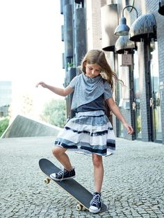 Katrina Tang Photography for Mimi Disain SS 15. Girl wearing a skirt riding a skateboard, city #katrinatang #tangkatrina
