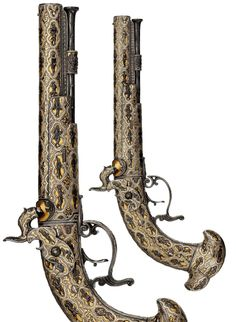 A pair of Spanish percussion chiseled and damascened pistols, of exhibition quality, the workshops of Eusebio Zuloaga, Eibar or Madrid, ca, 1847-55