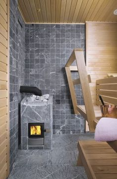 Cozy up to this tranquil grey soapstone sauna. Walk In Bath, Sauna Design, Outdoor Sauna, Finnish Sauna, Eco Buildings, Tub Shower Combo, Best Cleaning Products, Spa Rooms, Steam Room