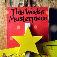 A lovely wooden star peg with lettering: 'This week's masterpiece'Angelic Hen has a wide range of little pegged out products, please see our products page for other designs.A perfect gift for any proud mum, dad, auntie, uncle, godparent or grandparent. This lovely wooden hand painted peg with a yellow star and red spotty background allows proud family to display their children's artwork. The pegs are made by our wild Welsh artists in Angelic Hen's beautiful Wye Valley studio. The wooden ...
