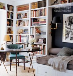 Corner office with built-in bookcase backdrop and reading nook.