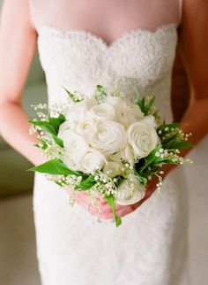 Mix Lilies of the Valley with ranunculuses for a fresh, clean effect | Brides.com