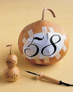 Gourd House Numbers  For a functional entryway decoration, emblazon a gourd with your house number. Print the number in any font and size.  Gourd Numbers How-Tos