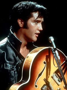 Elvis - because, like John Lennon, it would be great just to have him back.