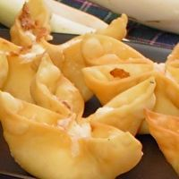 Baked Crab Rangoon - pretty good! The oven burns the corners of the wontons so I folded just in half