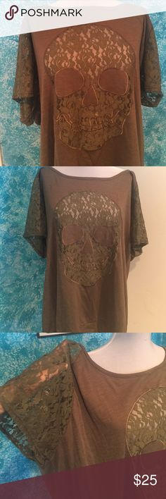 SALE TODAY!! NWT plus size skull shirt! This shirt it green with a lace see through skull on the front and lace sleeves. This is new with tags. Very cute top! torrid Tops Blouses