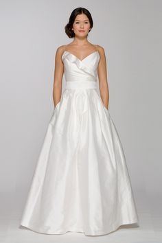 The #Lucy gown features ruffled surplice with spaghetti straps I @AriaDress