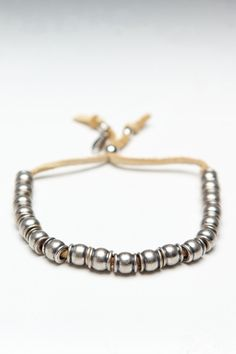 Collared Barrel Beads Deerskin Leather Bracelet Tan/Silver  You can make this yourself sooooo easily!