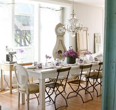 : Bright Rustic Styled Home Dining Space Idea With Simple White Table And Wooden Chairs Under Chandeliers