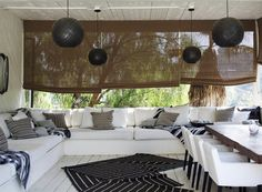 Nate Berkus in his Los Angeles Home | Rue white outdoor furniture, black globe lights, black and white mats