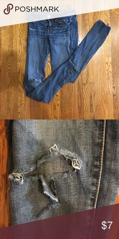 American Eagle stretch jegging Gently worn stretch jegging with hole in right knee. Color is a lighter wash denim American Eagle Outfitters Jeans Skinny