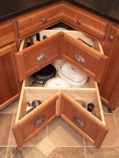 What a neat idea!!  i think I would leave out some of those dividers so you could put long handled frying pans in there.