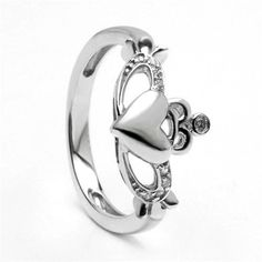 "This beautiful sterling silver Claddagh ring is accented on the crown and arms with brilliant CZ stones, and measures approximately 3/8"" wide (.95 cm). The Claddagh is one of Ireland's most well known symbols and stands for love, loyalty and friendship. A gorgeous Claddagh ring with a unique look that provides a more modern alternative to this classic symbol. This beautiful Irish ring comes packaged in a high quality ring box making it perfect for gift giving! Made in Ireland."