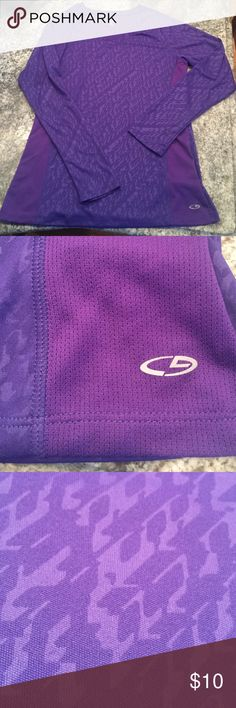 Purple 100% polyester long sleeve workout top 100% polyester. Purple. Slight v-neck. Long sleeve workout top. Only been worn a couple times. Great condition. Champion Tops Tees - Long Sleeve